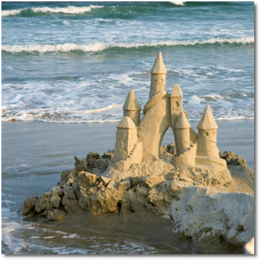 Sandcastle at the beach with the tide coming in.