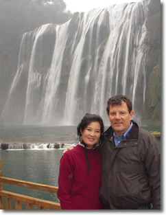 Nicholas Kristof and wife at waterfall
