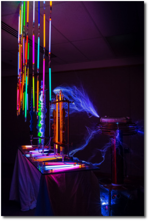 Tesla coil powers glass tubes of noble gasses